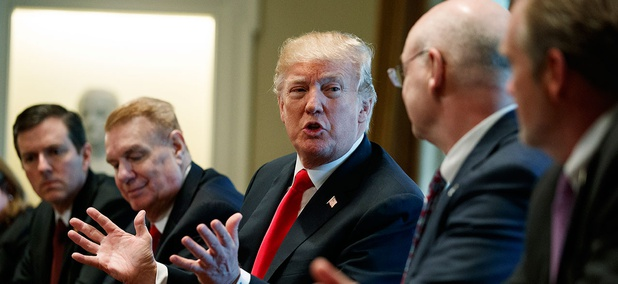 President Donald Trump speaks during a meeting with steel and aluminum executives in the Cabinet Room of the White House on March 1.
