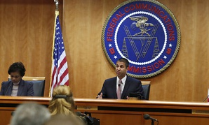 FCC Chairman Ajit Pai, center, sits next to Commissioner Mignon Clyburn, left, and Commissioner Michael O'Rielly.