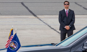 A Secret Service agent stands guard during the arrival of President Donald Trump aboard Air Force One in Ronkonkoma, New York in July.
