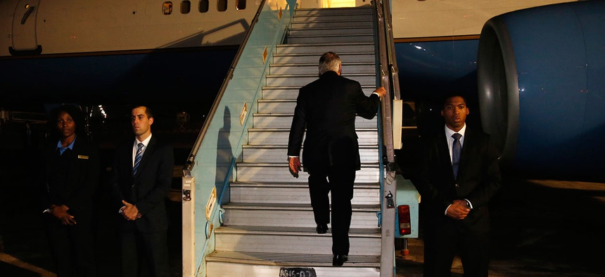 Rex Tillerson boards his plane to depart at the end of a five-country swing through Africa from Abuja, Nigeria, on March 12, 2018.