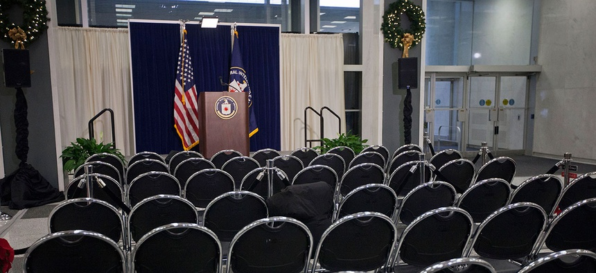 The stage podium and chairs are seen set up before the start of CIA Director John Brennan's news conference at CIA headquarters in 2014.