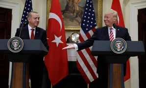 President Donald Trump, right, reaches to shake hands with Turkey's President Recep Tayyip Erdogan in 2017.