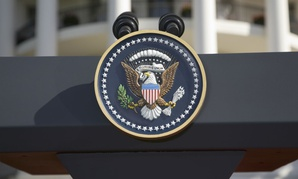 The presidential seal on a podium outside the White House.