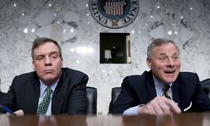 Senate Intelligence Chairman Richard Burr, R-N.C., right, accompanied by Committee Vice Chairman Mark Warner, D-Va.