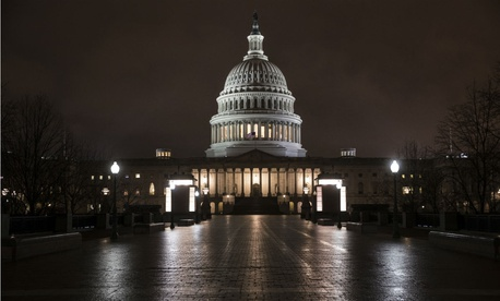 The Capitol before dawn Wednesday after a night of negotiating on the $1.3 trillion omnibus bill to fund government operations.
