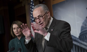 Senate Minority Leader Chuck Schumer, D-N.Y., with House Minority Leader Nancy Pelosi, D-Calif., speaks to reporters March 22 about the massive government spending bill moving through Congress.