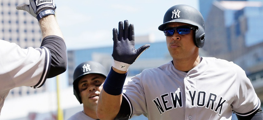 Alex Rodriguez gives teammates high fives in 2016.