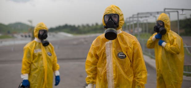 Army soldiers dressed in hazmat suits take part in a security drill at the Deodoro Olympic Park, in Rio de Janeiro, Brazil, Friday, March 11, 2016. Brazilian army personnel took part in the security drill as preparation for the 2016 Olympic Games.