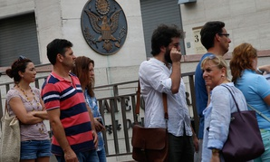 People wait to enter the visa section of the United States consulate building in Istanbul in 2015.