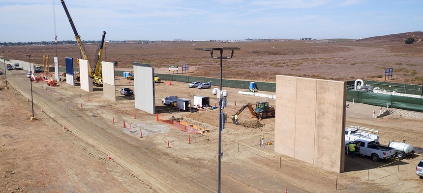 Construction crews prepare a set of border wall prototypes along the U.S. border with Mexico in October.