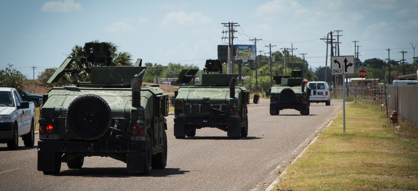 A convoy of Texas National Guard vehicles departs to the Texas-Mexico border in 2014 as part of Obama'sOperation Strong Safety .