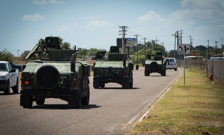 A convoy of Texas National Guard vehicles departs to the Texas-Mexico border in 2014 as part of Obama's Operation Strong Safety .