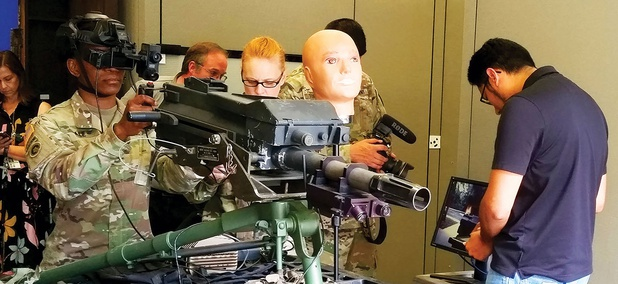 Sgt. 1st Class Taikeila Dale uses the Mk-19 simulator with augmented reality head-mounted display in August.