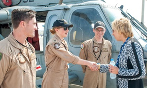 """Ellen Lord meets the """"Wildcards"""" of Helicopter Sea Combat Squadron 23 during the International Air Show in the Dubai World Center in November."""