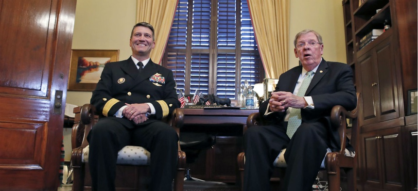 Navy Rear Adm. Ronny Jackson, M.D., left, sits with Sen. Johnny Isakson, R-Ga., chairman of the Veteran's Affairs Committee, before their meeting on April 16.
