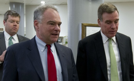 Virginia Democratic Sens. Tim Kaine (left) and Mark Warner walk to the Senate floor earlier this year.