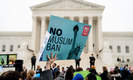 A person holds a sign during a rally at the Supreme Court building on Wednesday.