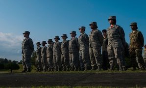 U.S. Air Force Airmen stand parade rest before a retreat ceremony in March.