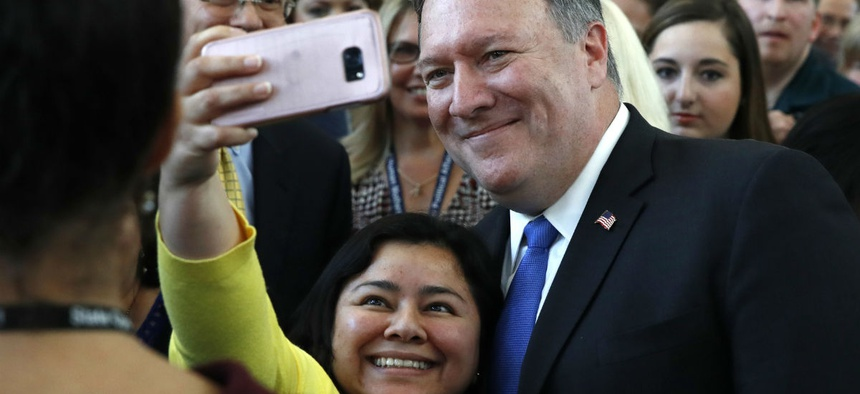 New State Department Secretary Mike Pompeo takes a selfie with an employee after his speech Tuesday.