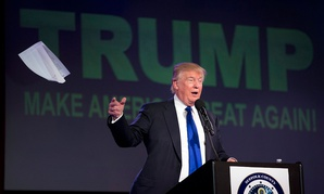 Then-candidate Donald Trump tosses his notes as he speaks during a Republican committee fundraising reception in 2016.