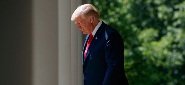 """President Donald Trump arrives for a """"National Day of Prayer"""" event in the Rose Garden of the White House Thursday."""