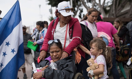 Members of a Central American family traveling with a caravan of migrants prepare to cross the border and apply for asylum in the United States in Tijuana in April.