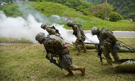 Competitors pull simulated casualties during the stress shoot event during the Eighth Army Best Warrior Competition, held at Camp Casey, Republic of Korea, in May.