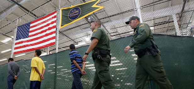 Young detainees are being escorted to an area to make phone calls as hundreds of mostly Central American immigrant children are being processed and held at the U.S. Customs and Border Protection Nogales Placement Center in Nogales, Ariz., in 2014.