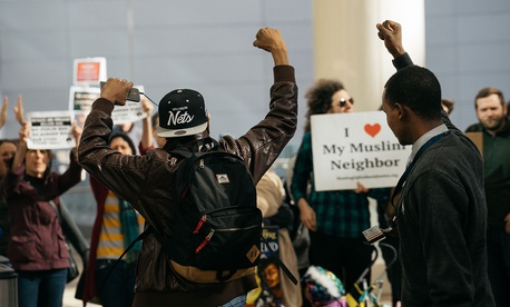 Protestors rally at Denver International Airport in 2017 in reaction to President Donald Trump's travel ban.