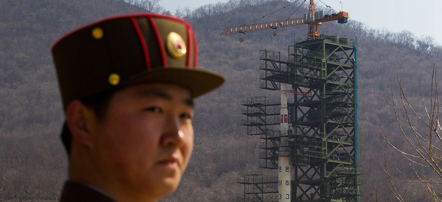 A North Korean soldier stands in front of the country's Unha-3 rocket, slated for liftoff between April 12-16, at a launching site in Tongchang-ri, North Korea on Sunday April 8, 2012. North Korean space officials have moved a long-range rocket.