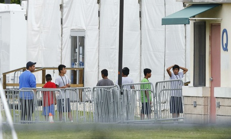 Immigrant Children Walk In A Line Outside The Homestead Temporary Shelter For Unaccompanied Florida
