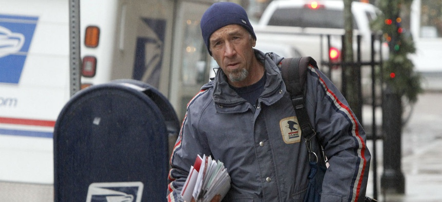 Postal worker Mike Gillis delivers mail in Vermont.