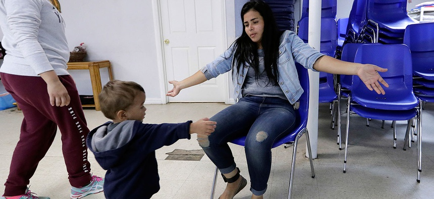 Jennifer Chevarria, from Nicaragua, opens her arms for son, Jayden, 2, at the Catholic Charities RGV Thursday, June 21, 2018, in McAllen, Texas. The family was processed and released by CBP Tuesday and are waiting to travel to relatives in California .