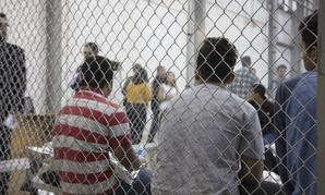 U.S. Border Patrol agents conduct intake of illegal border crossers at the Central Processing Center in McAllen, Texas.