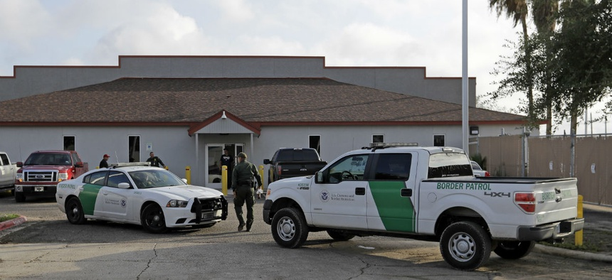 A Border Patrol Agent walks outside the Central Processing Center in McAllen, Texas.