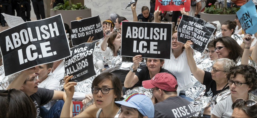 Hundreds of activists protest the Trump administration's approach to illegal border crossings in a demonstration at the Hart Senate Office Building on Capitol Hill on June 28.