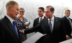 Health and Human Services Secretary Alex Azar, right, assures Sen. Bill Nelson, D-Fla., left, that they'll get him in touch with staff in response to his question about children who have been separated from their parents after a hearing in June.