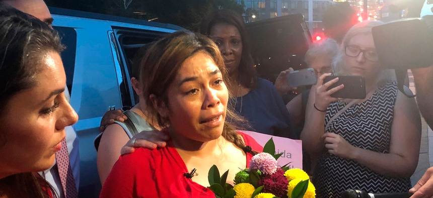 An immigrant mother separated from her children speaks to reporters in New York on July 2.