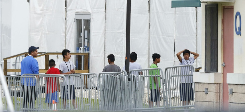 Immigrant children walk outside the Homestead Temporary Shelter for Unaccompanied Children in Florida.