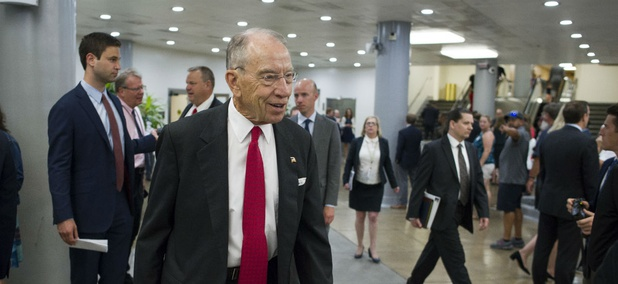 Sen. Chuck Grassley, R-Iowa, walks to a subway car following a vote on Capitol Hill on July 11.