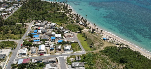 Blue tarps cover homes in Puerto Rico that were still damaged nine months after Hurricane Maria hit.