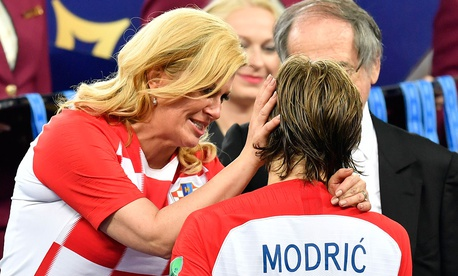 Croatian President Kolinda Grabar-Kitarović hugs Croatia's Luka Modrić after France won the final match between France and Croatia at the 2018 soccer World Cup.