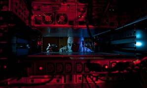 U.S. Air Force Staff Sgt. Jerome Duhan, a network administrator with the 97th Communications Squadron, inserts a hard drive into the network control center retina server at Altus Air Force Base.