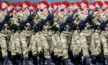 Russian troops march during the Victory Day military parade to celebrate 73 years since the end of WWII and the defeat of Nazi Germany, in Moscow, Russia, Wed, May 9, 2018