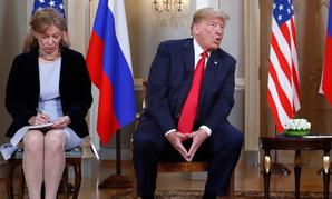 Marina Gross, left, takes notes when Trump talks to Putin in Helsinki.