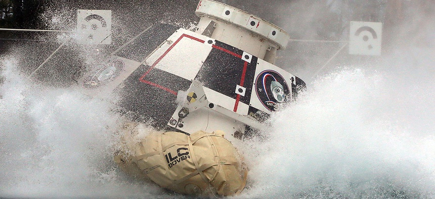A mock-up of Boeing's CST-100 Starliner splashes down in 2016