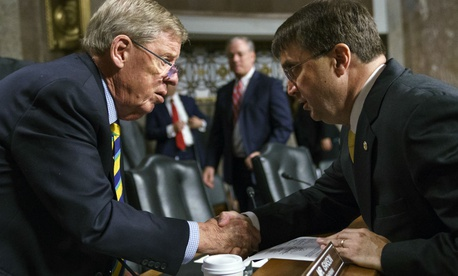 Robert Wilkie, right, shakes hands with Senate Veterans Affairs Committee chairman Johnny Isakson, R-Ga., left, after a nomination hearing in June.