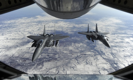 The proposed F-15X will have a one-person cockpit, not the pilot-and-weaponeer team in these F-15E Strike Eagles.