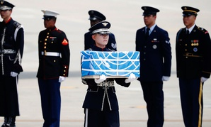 A soldier carries a casket containing the remains of a U.S. soldier who was killed in the Korean War during a ceremony at Osan Air Base in South Korea on July 27.