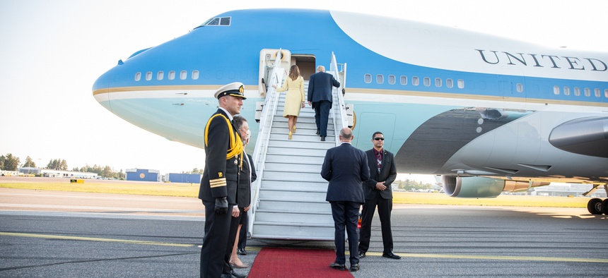 President Donald J. Trump and First Lady Melania Trump board Air Force One after the Helsinki summit on July 16.